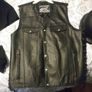 Motorcycle helmet..size (m) and leather vest 2xl t